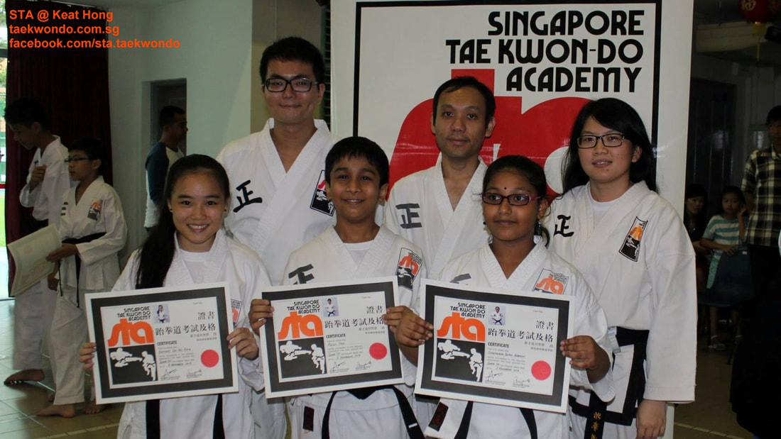 Black Belt Certificates Awards STA Keat Hong Senior Instructor Alvin Ang and Toh Pei Xuan and Asst Tan Chun Boon